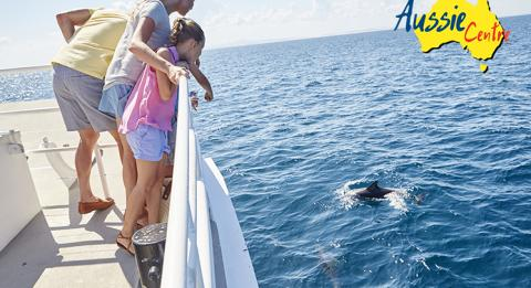 A family enjoys whale and dolphin cruise at Nelson Bay in Port Stephens